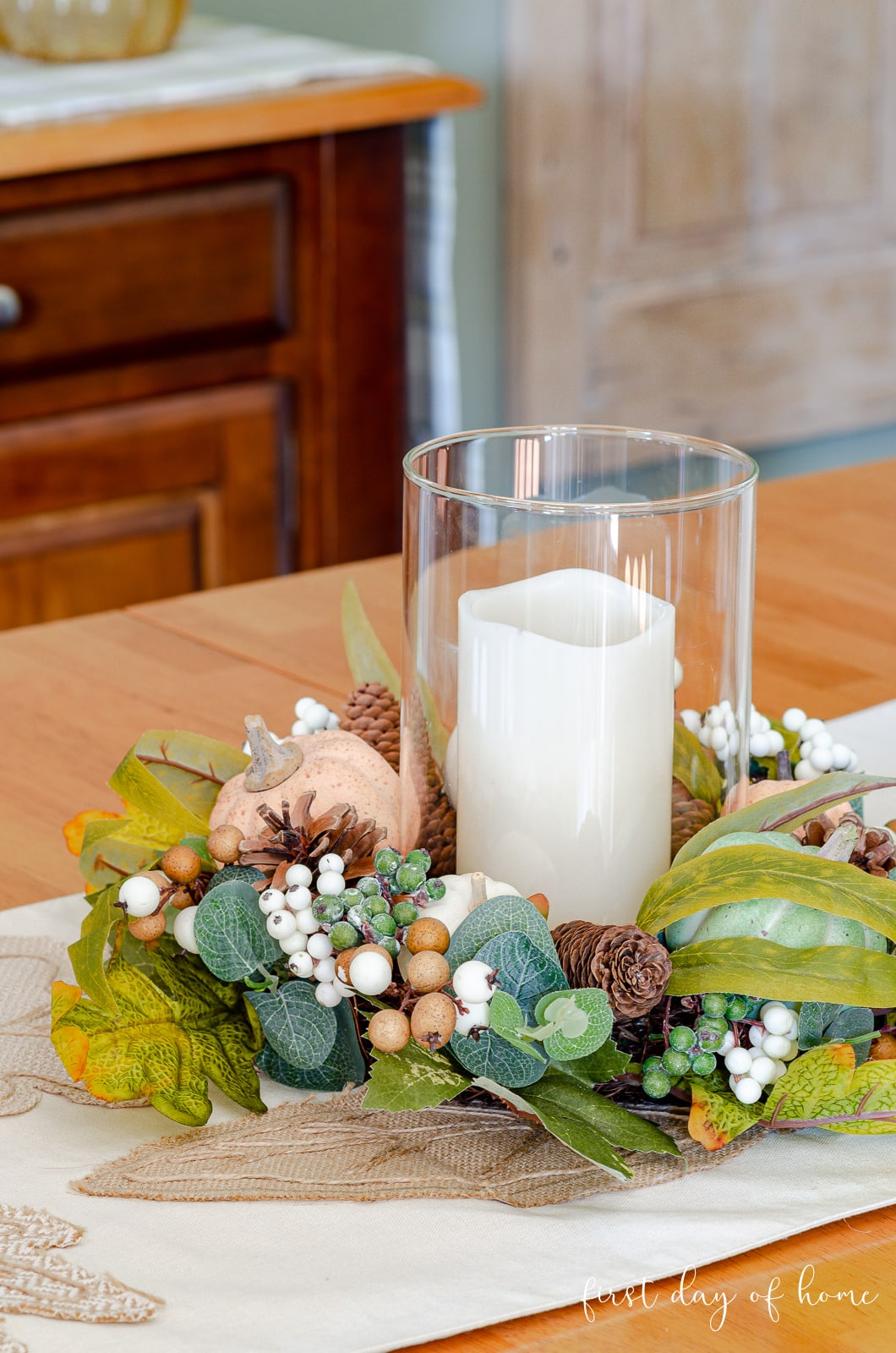 Fall hurricane candle with leaves and pumpkins