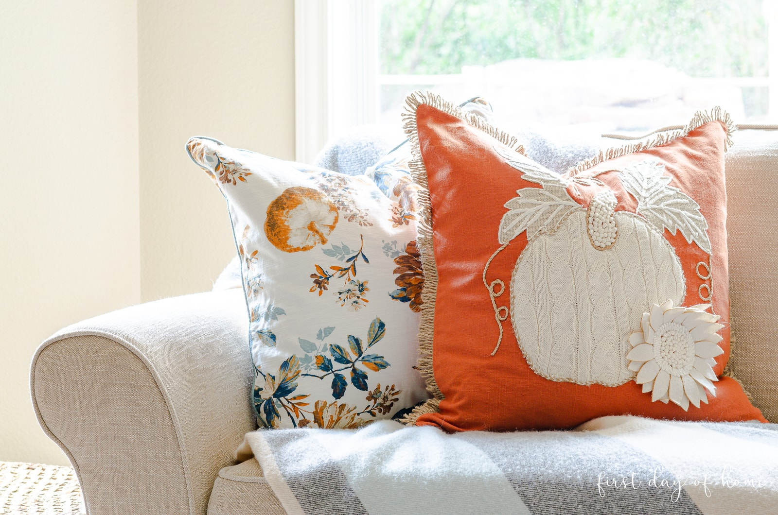 Fall pumpkin throw pillows on sofa