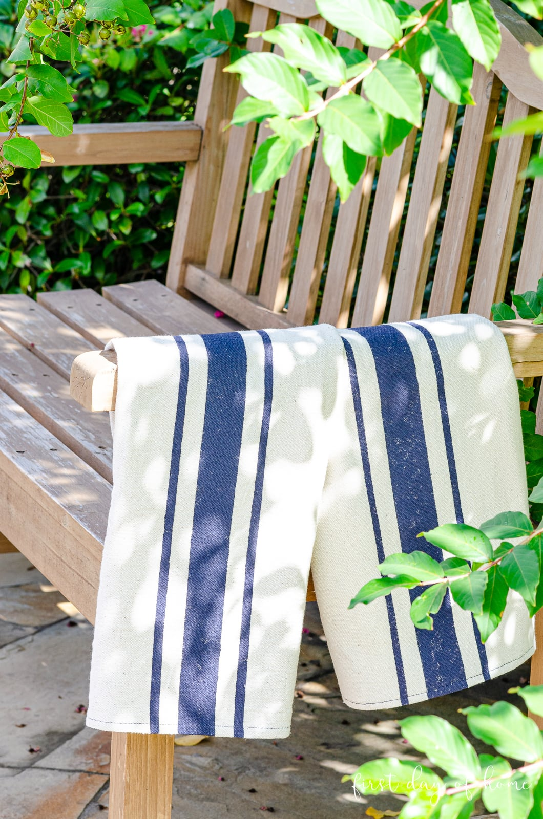 Flour sack dish towels on rustic farmhouse park bench