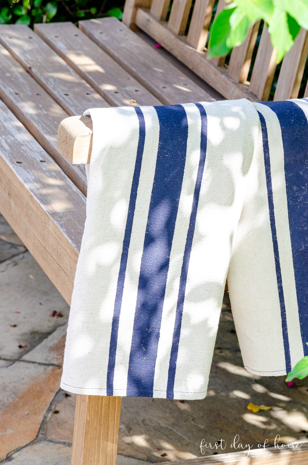 Flour sack dish towels hanging on farmhouse style bench