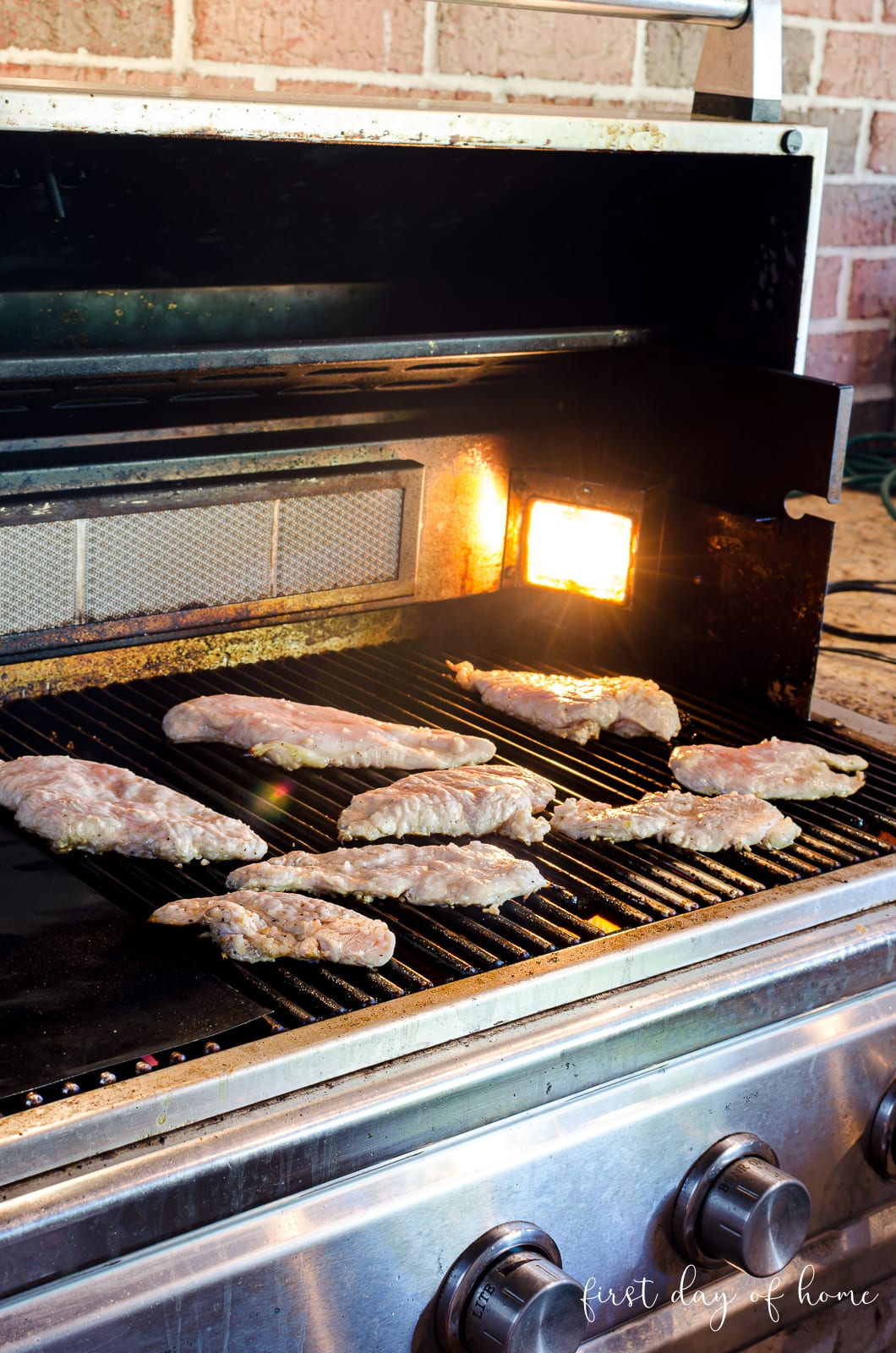 Chicken breasts cooking on a gas grill