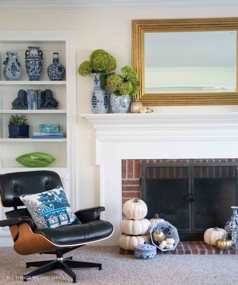 Blue and white themed Halloween mantel decor with subtle Halloween accents