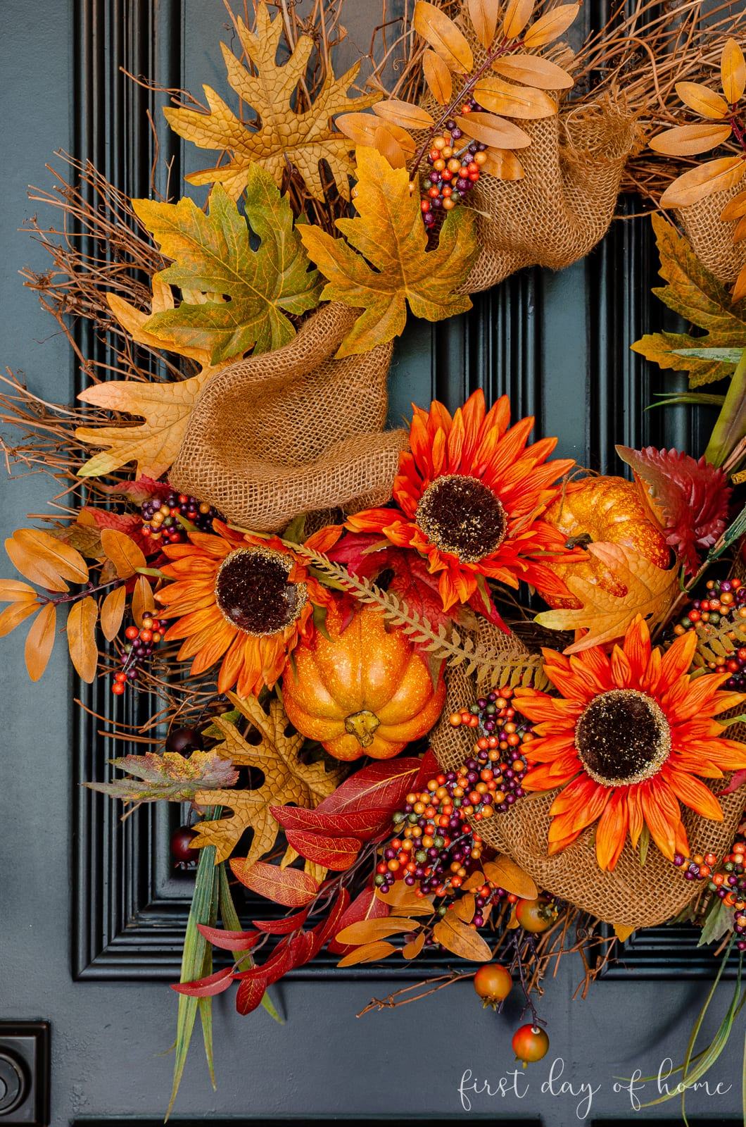 Fall grapevine wreath with pumpkins, leaves and sunflowers