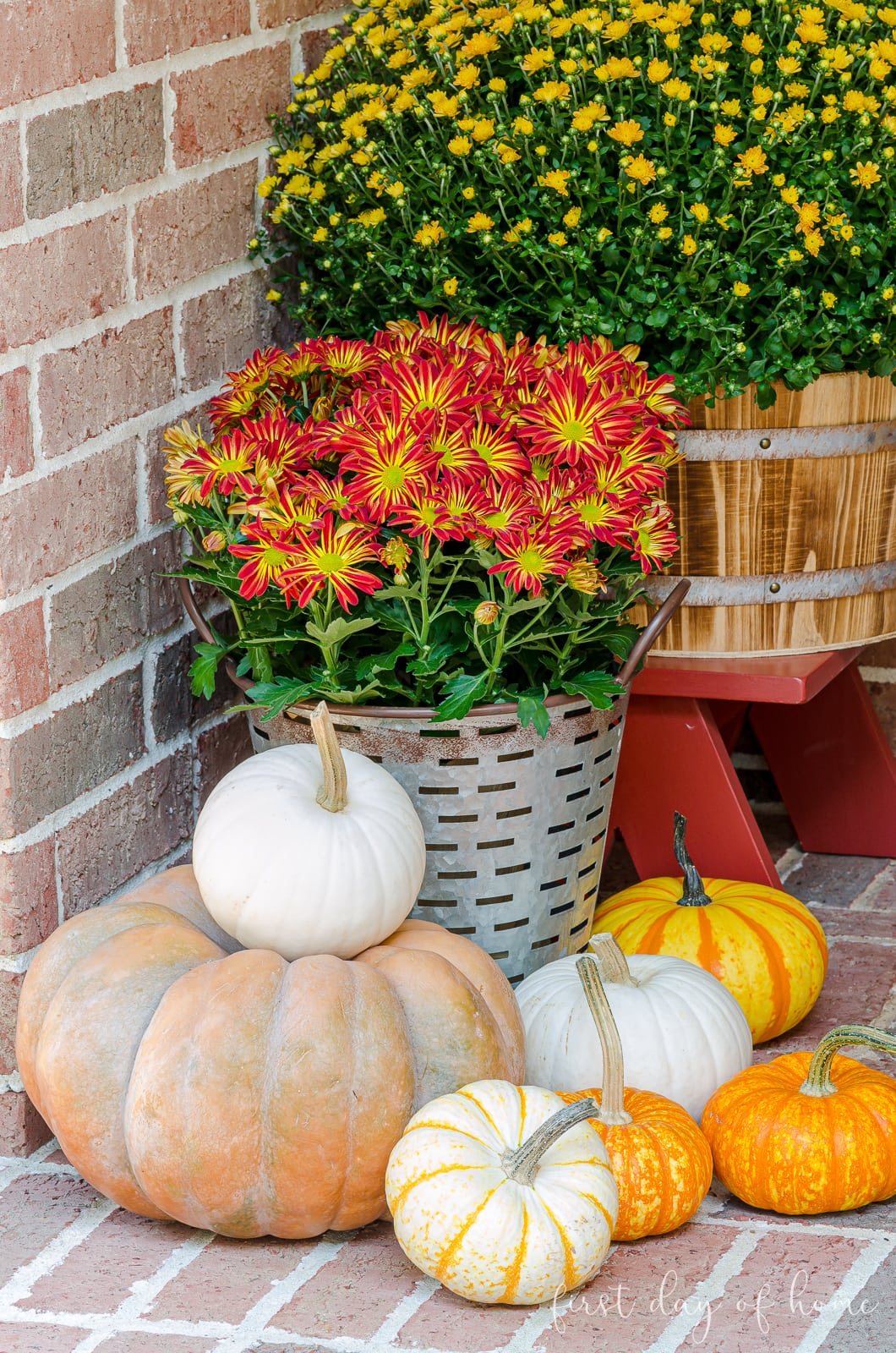 Various pumpkins on front porch fall decor