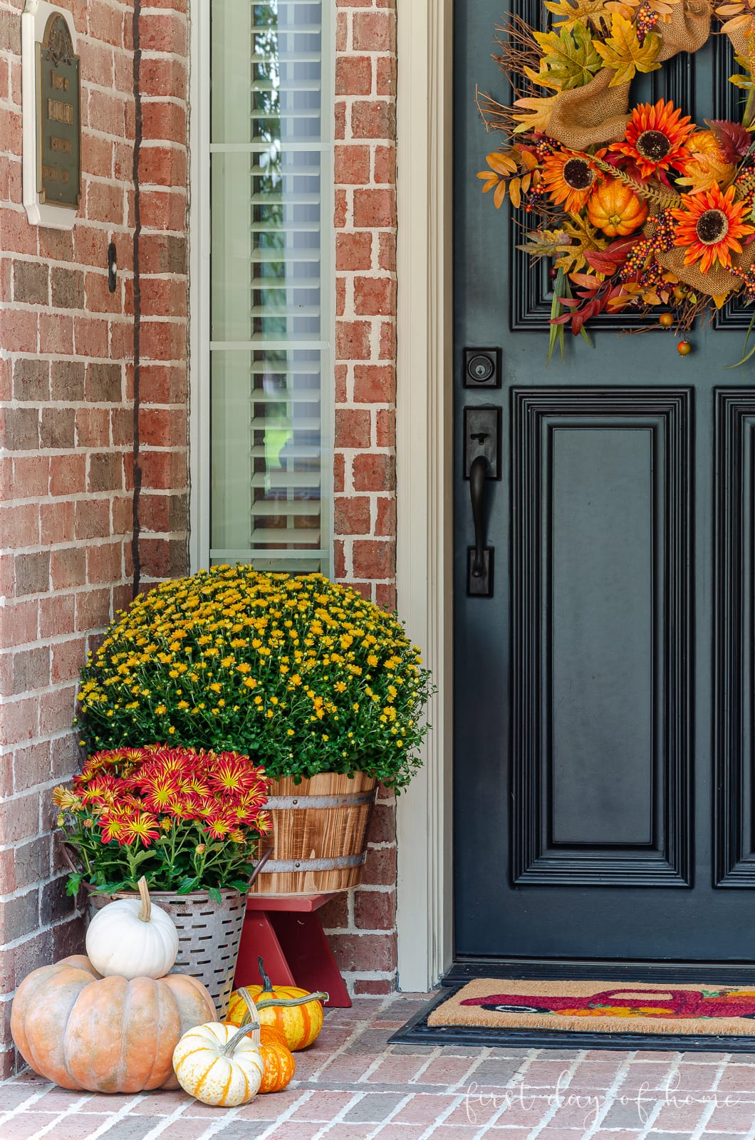 Fall porch decorating ideas with pumpkins, mums, fall welcome mat and fall wreath