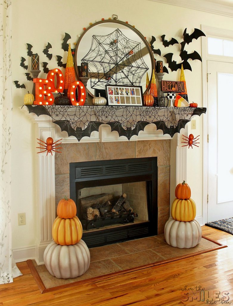 Halloween mantel with bats, Boo sign, pumpkin topiaries and spiders