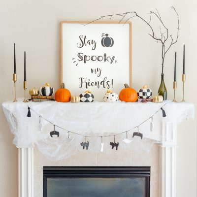 Halloween mantel decor with DIY crafts like farmhouse sign, dollar store pumpkins and salt dough ornament garland
