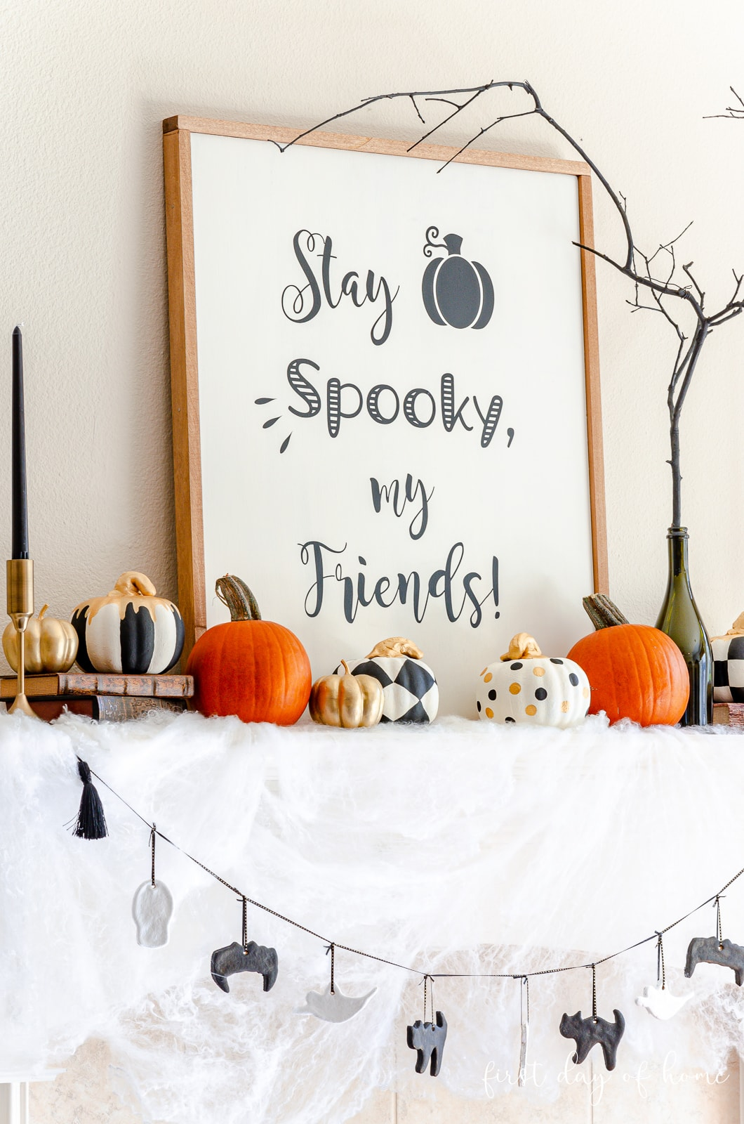 Halloween wood sign, painted dollar store pumpkins and salt dough ornaments on garland for Halloween mantel decor