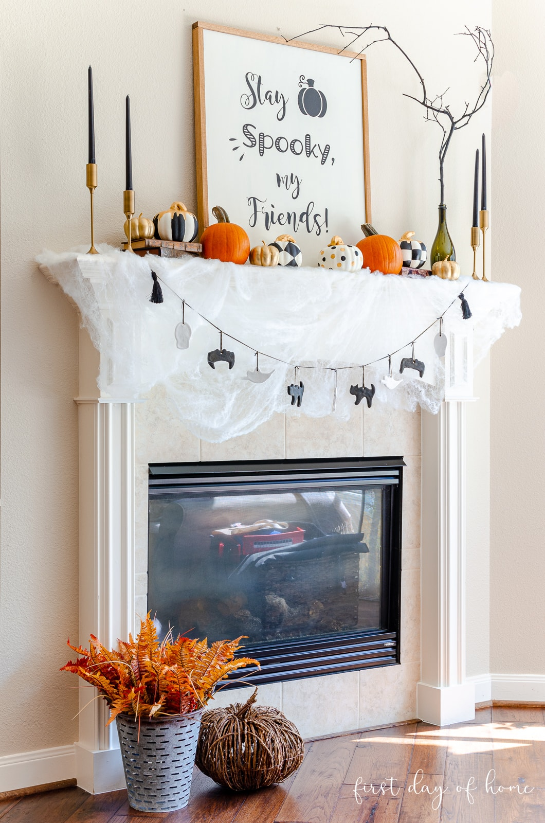 Halloween fireplace mantel decorations with DIY wood sign, salt dough ornaments for garland and painted foam pumpkins from Dollar Tree