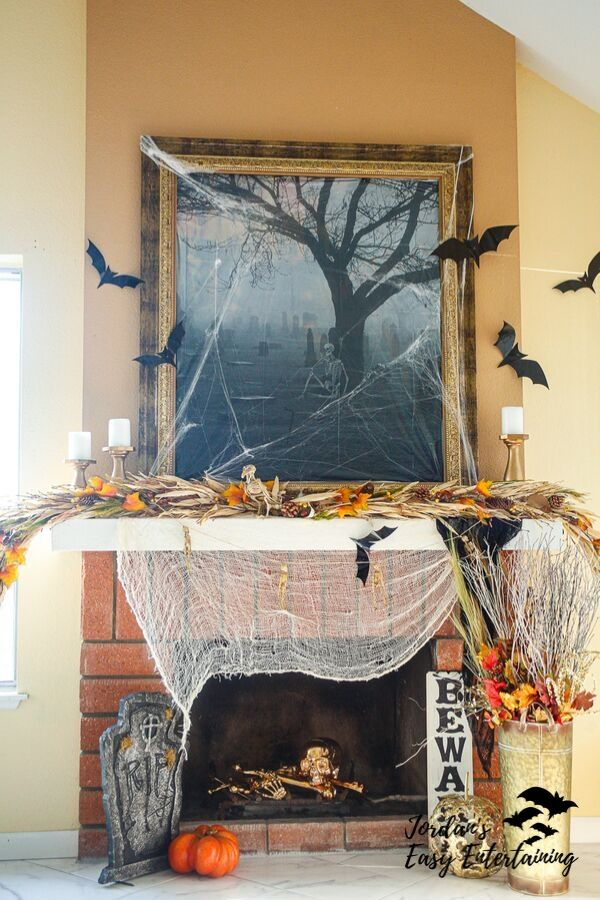 Spooky Halloween mantel decorations including skeletons, bats and dollar store items