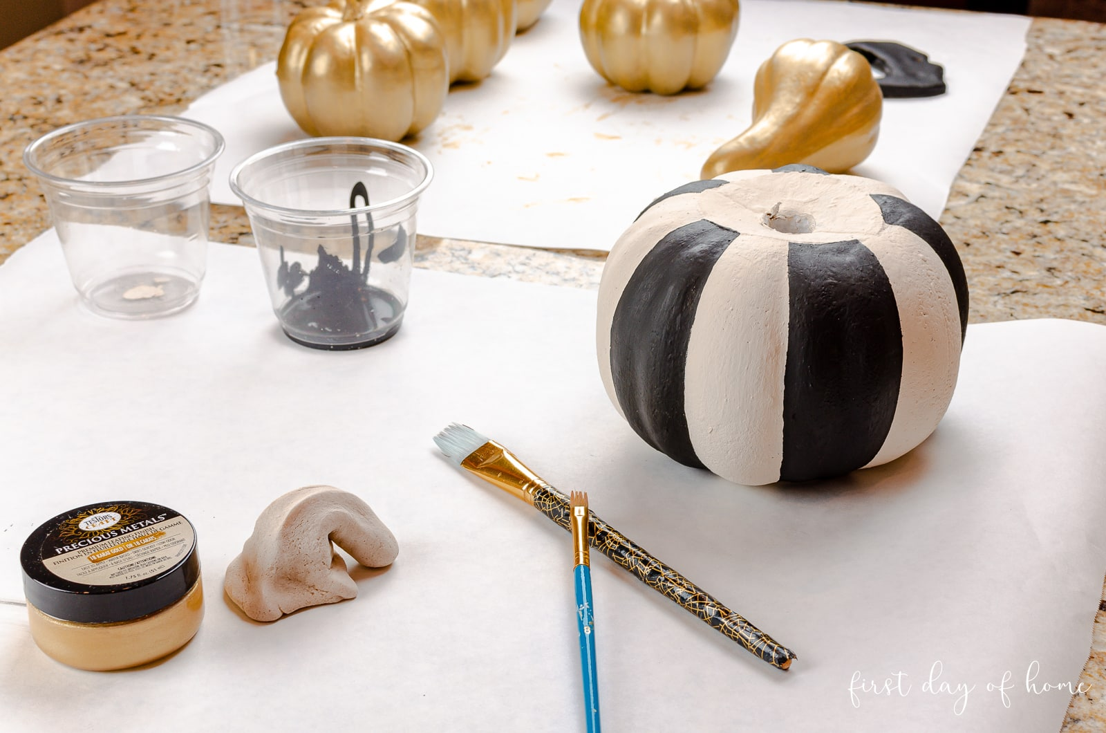 Painting foam pumpkins with chalk paint, acrylic paint and gold leaf paint