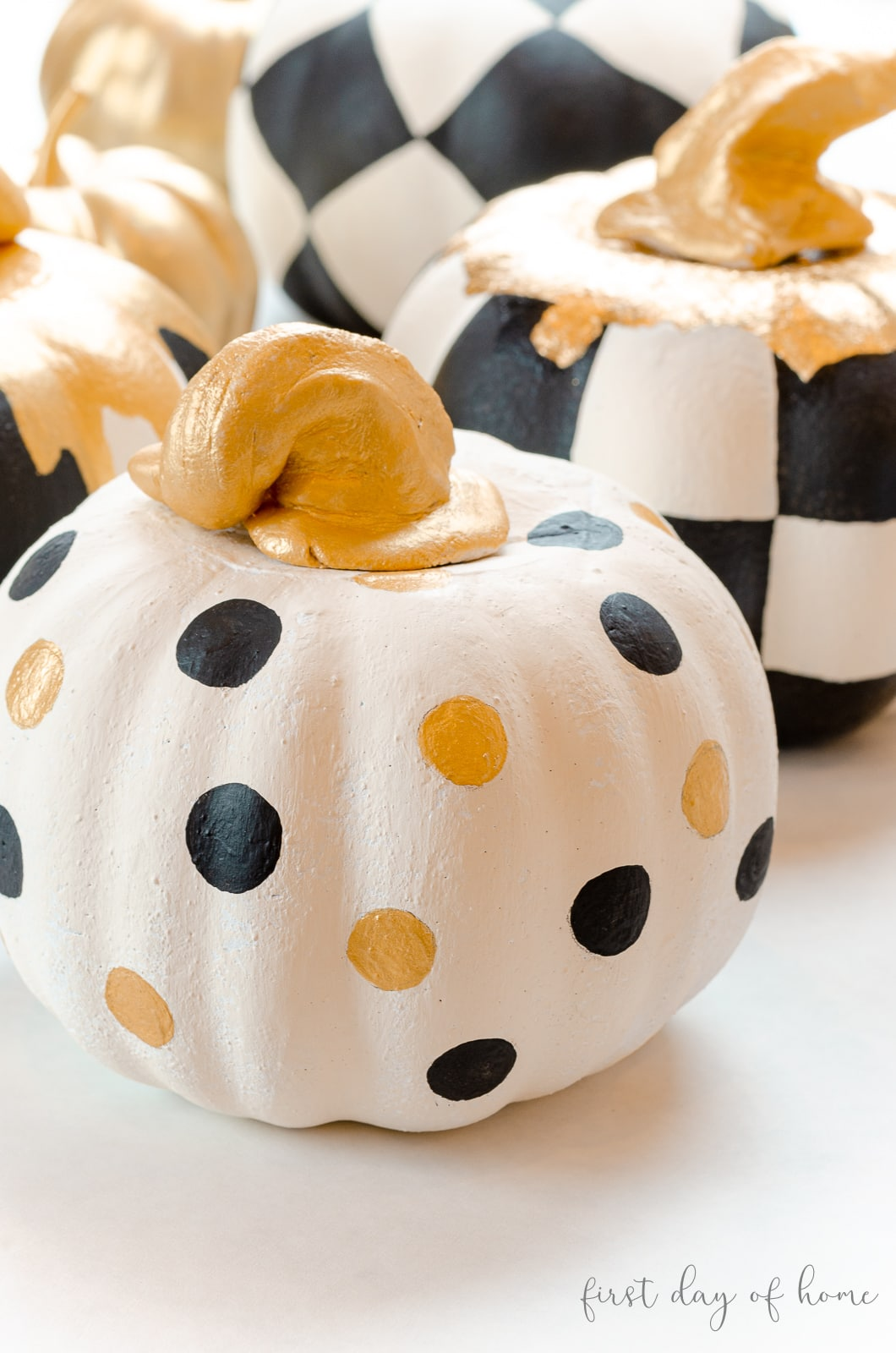White pumpkin with black and gold polka dots made from Dollar Tree foam pumpkins