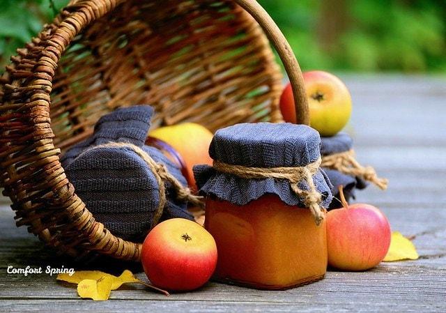 Apple butter in mason jar in harvest basket