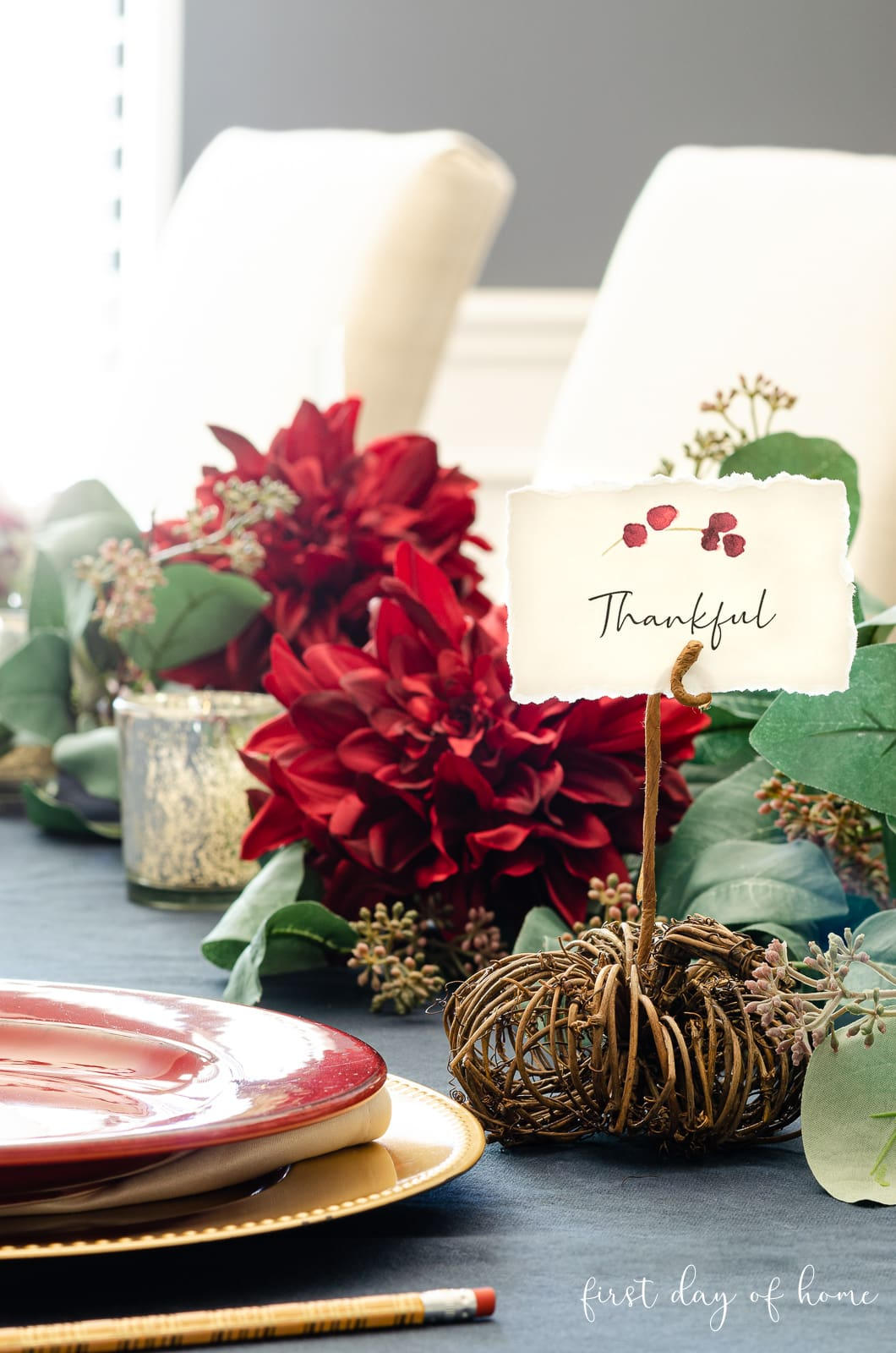 Simple Tablescapes for Thanksgiving using navy tablecloth, greenery garland and burgundy accents with DIY place cards