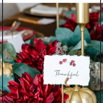 Thanksgiving tablescape decor with DIY pumpkin place card holders and faux floral greenery