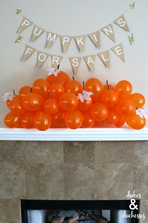 Orange balloon pumpkins on mantel for Halloween decor