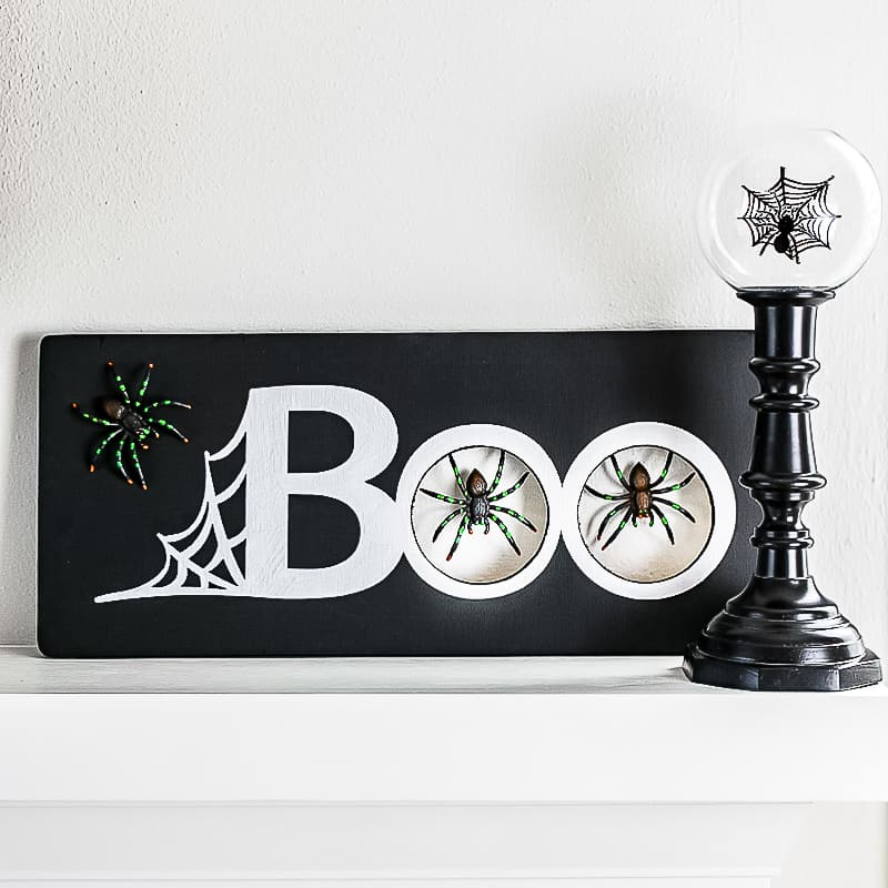 "Halloween mantel sign with the word ""Boo"" and spider design"