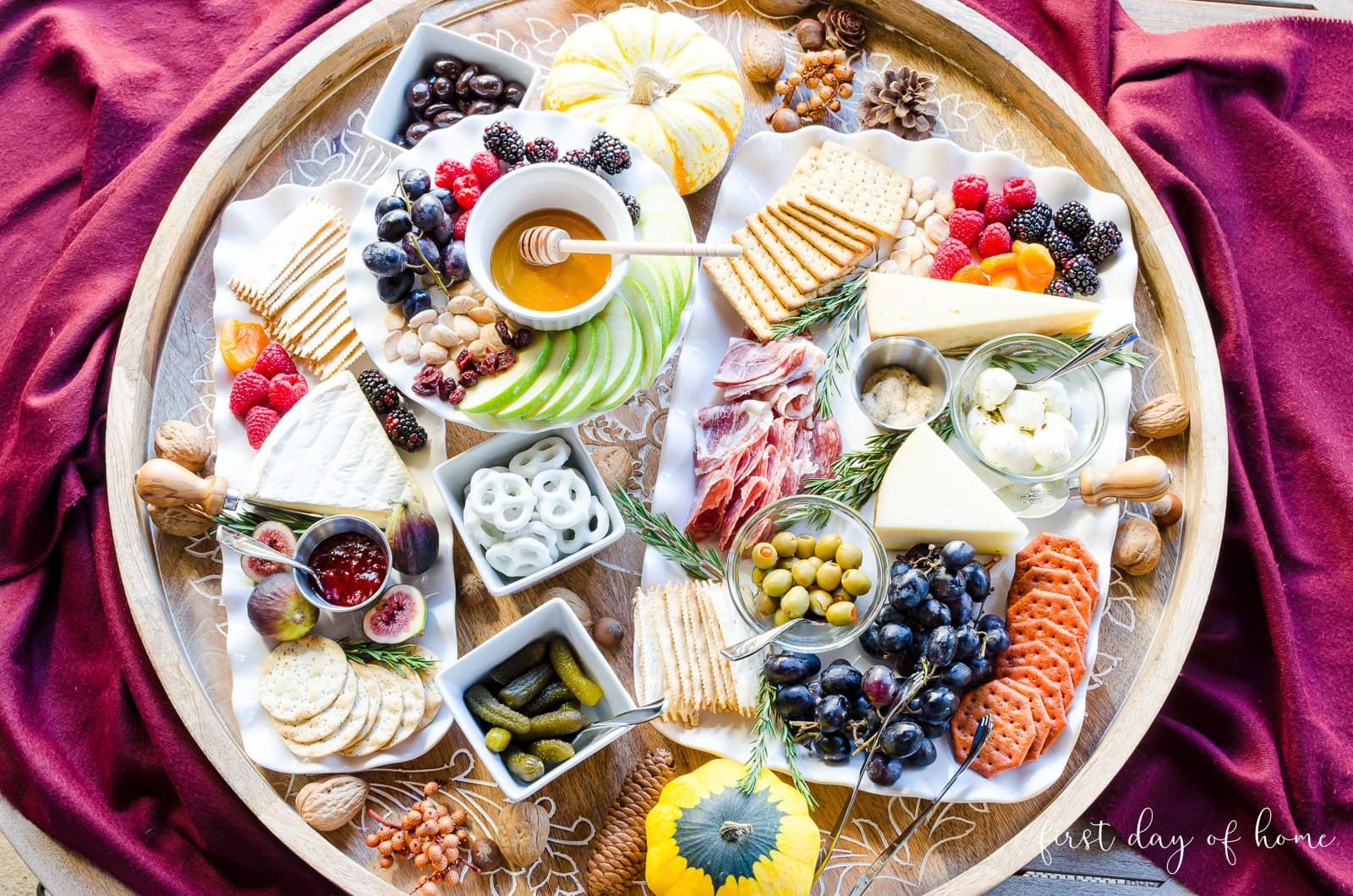 Charcuterie board with mix of specialty meats, cheeses, salty snacks, savory treats, crackers, fruit, preserves, pickled foods and more