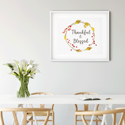 Free Thanksgiving printable art hanging on wall in front of Scandinavian table