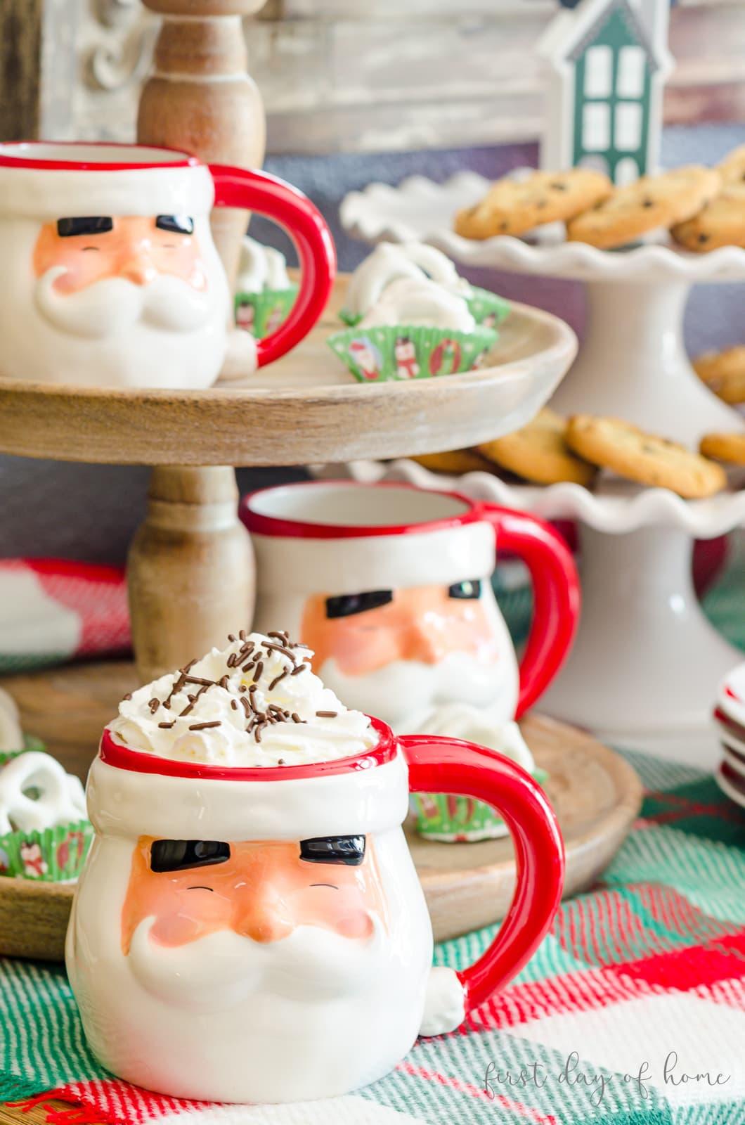 Santa mug with hot cocoa, whipped cream and chocolate sprinkles on hot cocoa bar