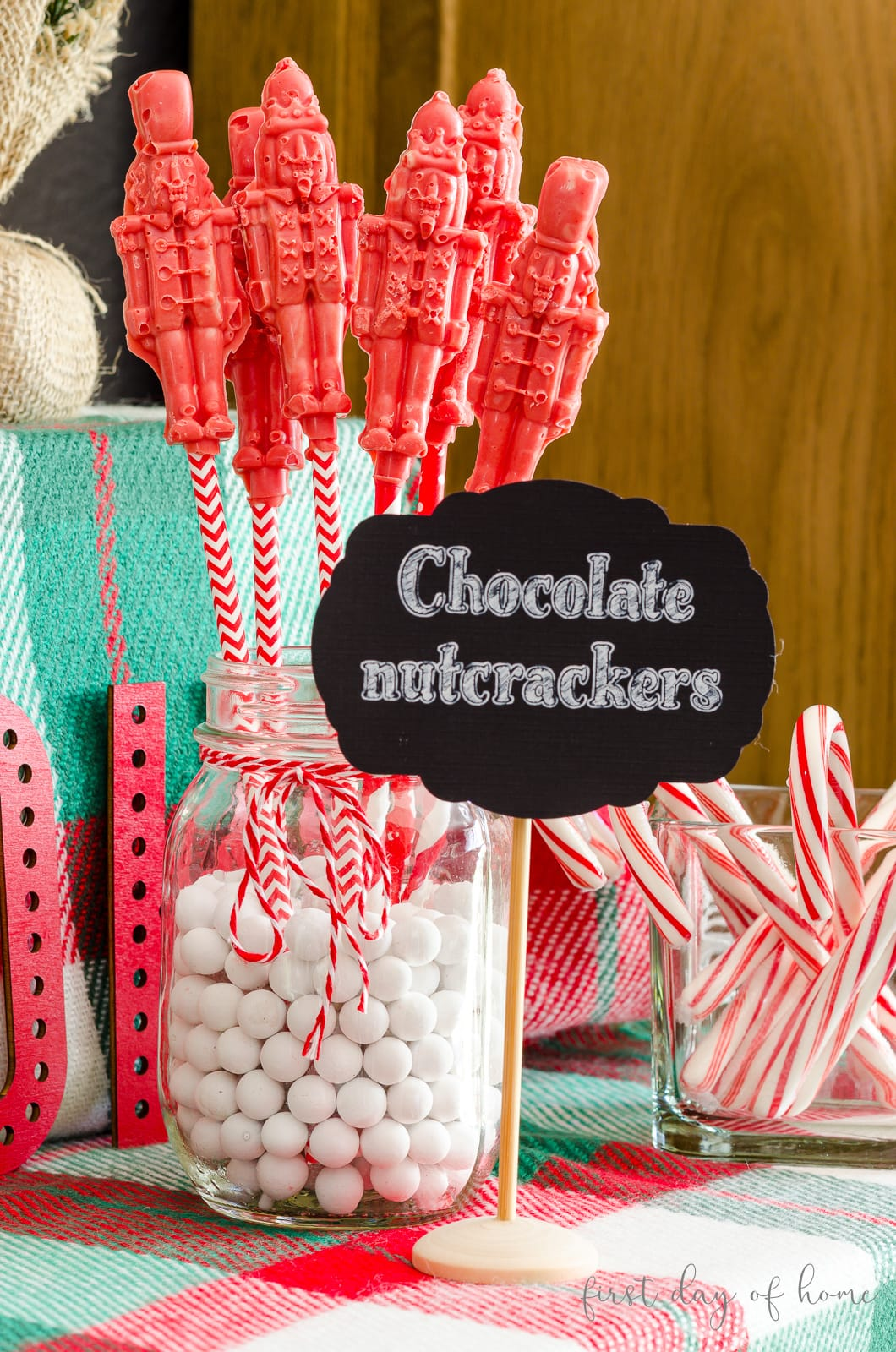 White chocolate nutcracker candies with chalkboard printable sign