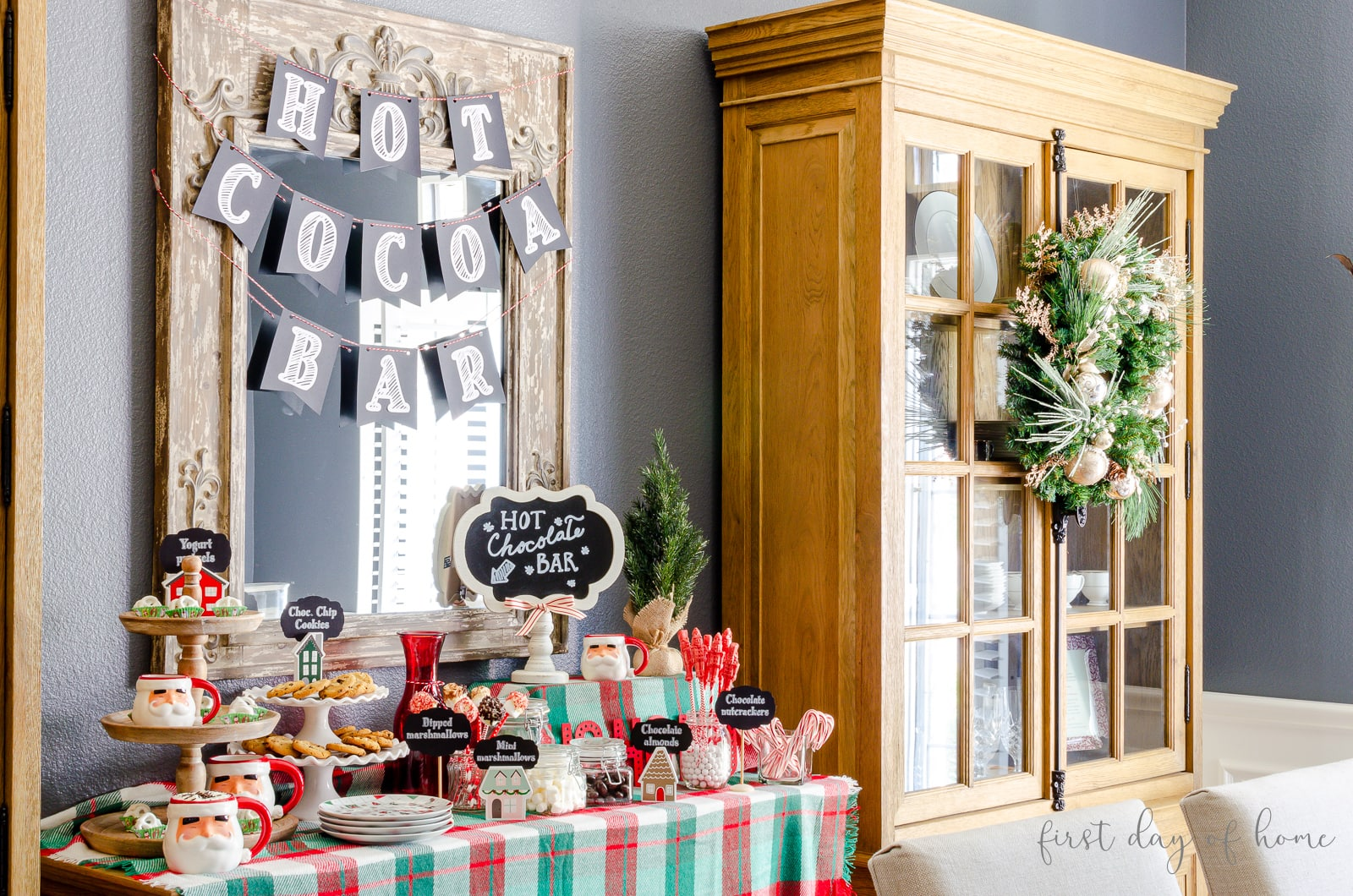 Hot cocoa bar with chalkboard signs and labels and cocoa toppings and accessories