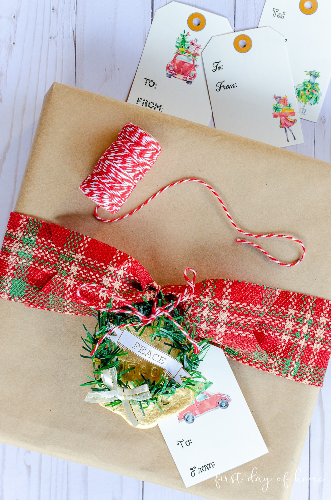 Free printable Christmas gift tags on brown paper wrapped gift with mini Christmas wreath and salt dough ornament