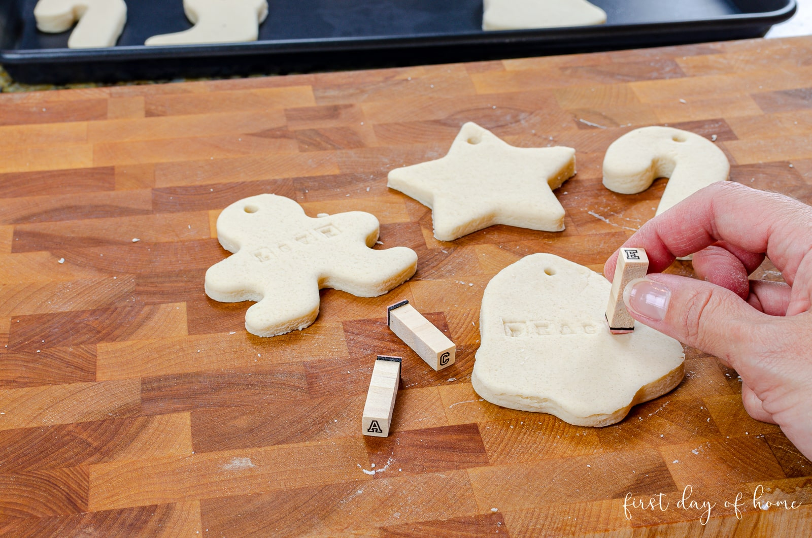 Inserting holes and stamping salt dough ornaments