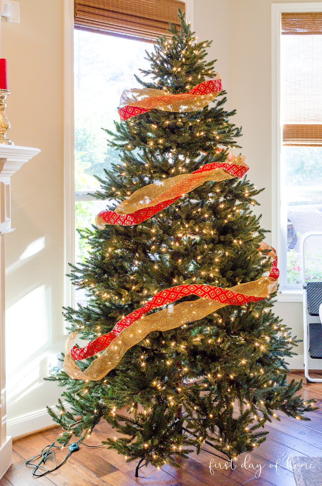 Christmas tree with a red ribbon and gold ribbon spiraling down from the top