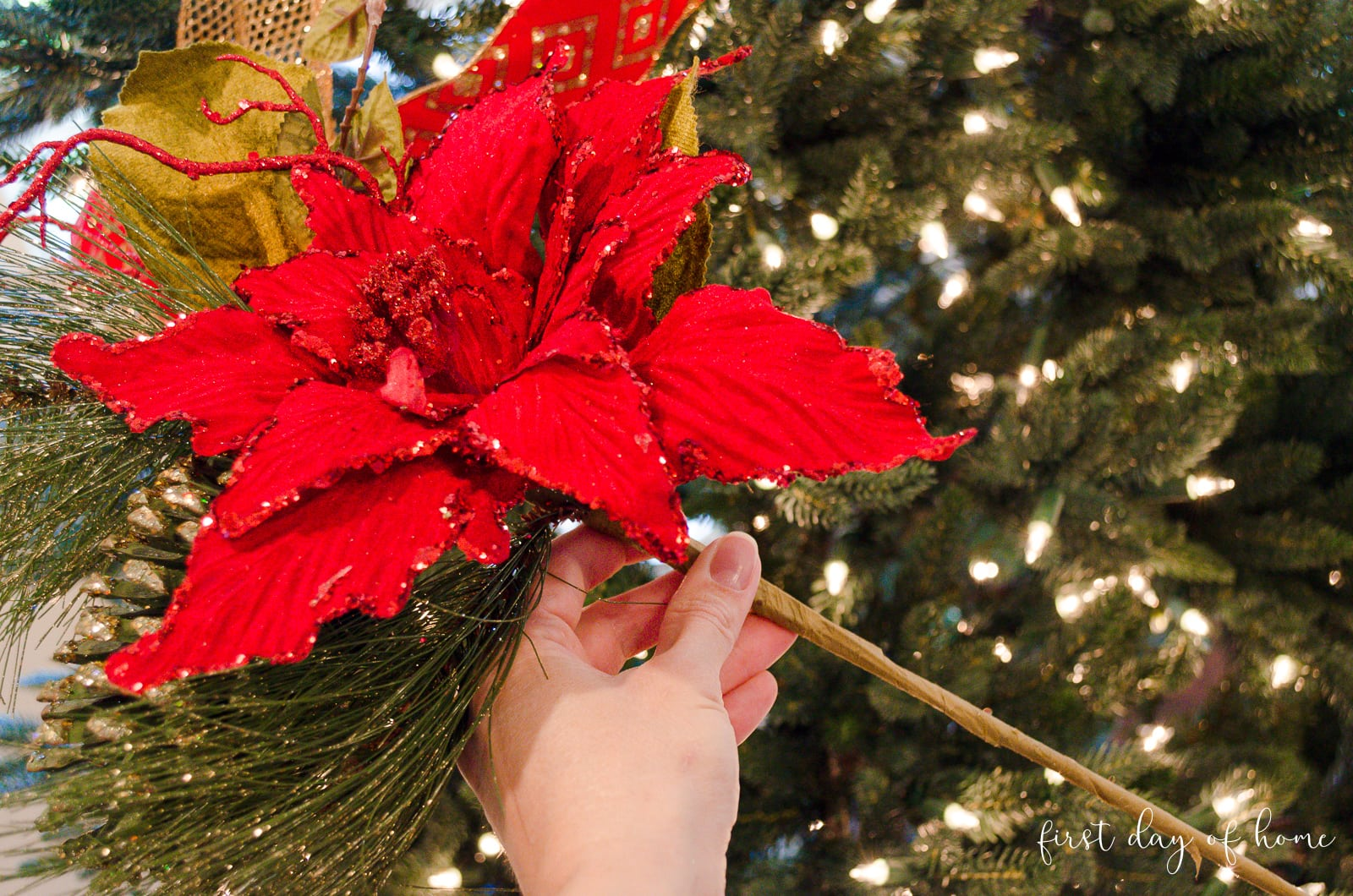 Floral pick with poinsettia, glitter pine cone and lime green leaves