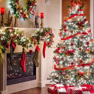 Pre-lit Christmas tree with elegant red and gold traditional Christmas tree decor with matching Christmas garland on mantel and Christmas wreath