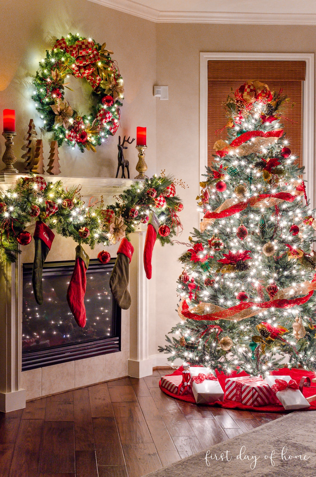 Christmas tree decorated with red and gold ribbon and floral picks for accents with coordinating garland and wreath on mantel