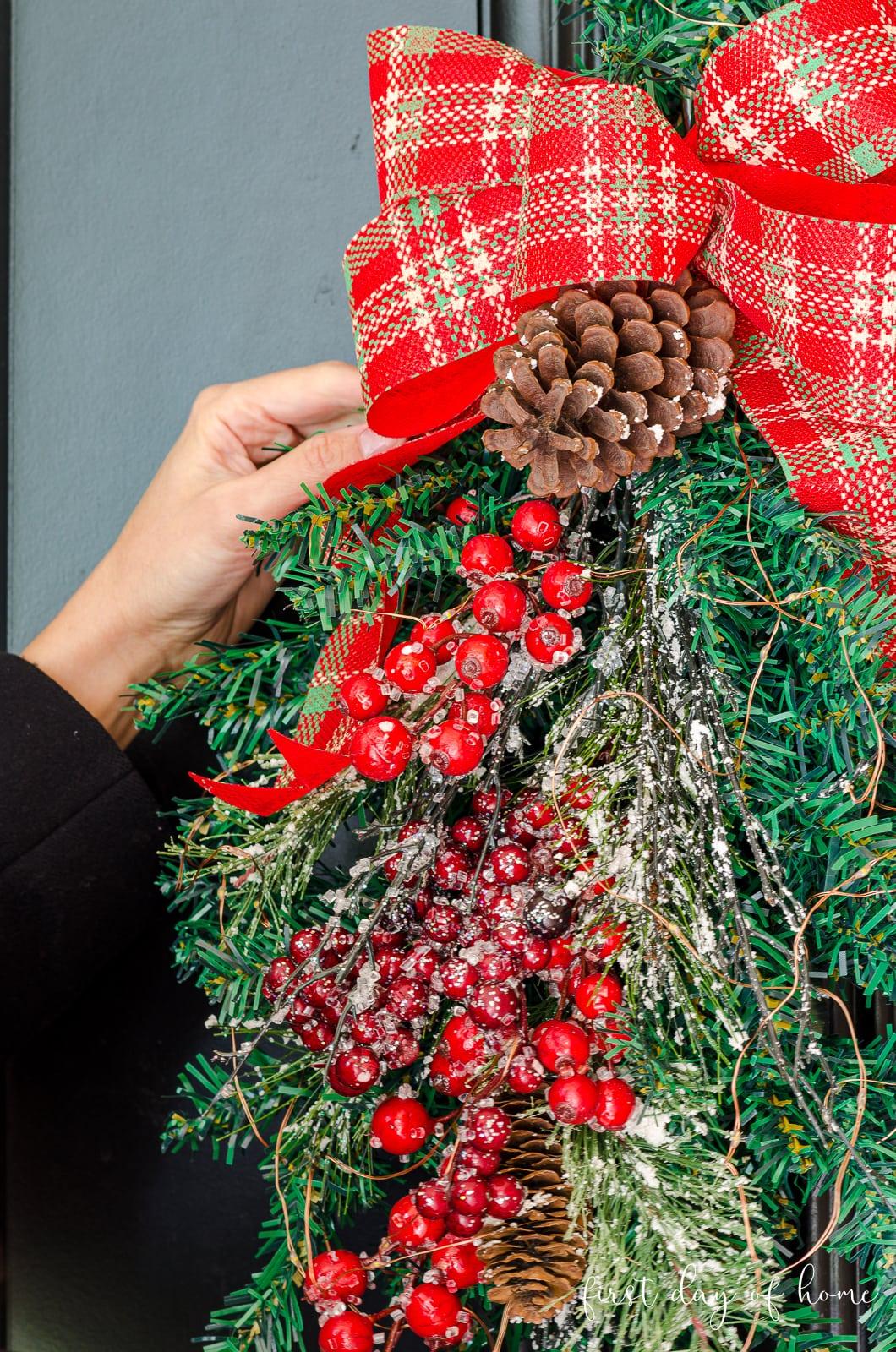 Hanging Christmas door swag on front door