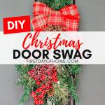 Christmas teardrop swag on black front door outdoors