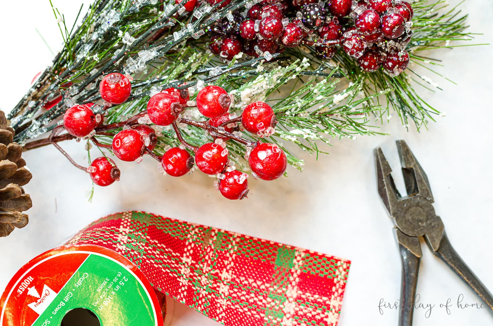 Christmas swag wreath supplies including red plaid ribbon and mixed winter berries