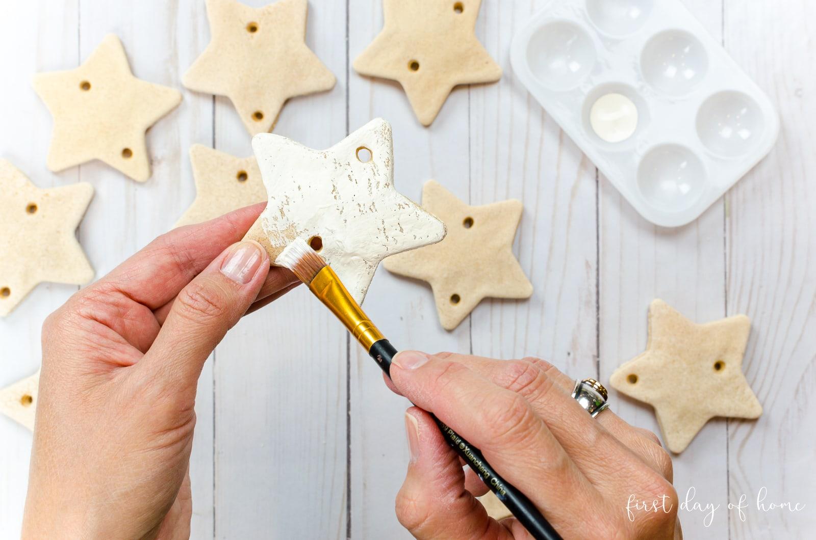 Painting salt dough ornaments with white chalk paint