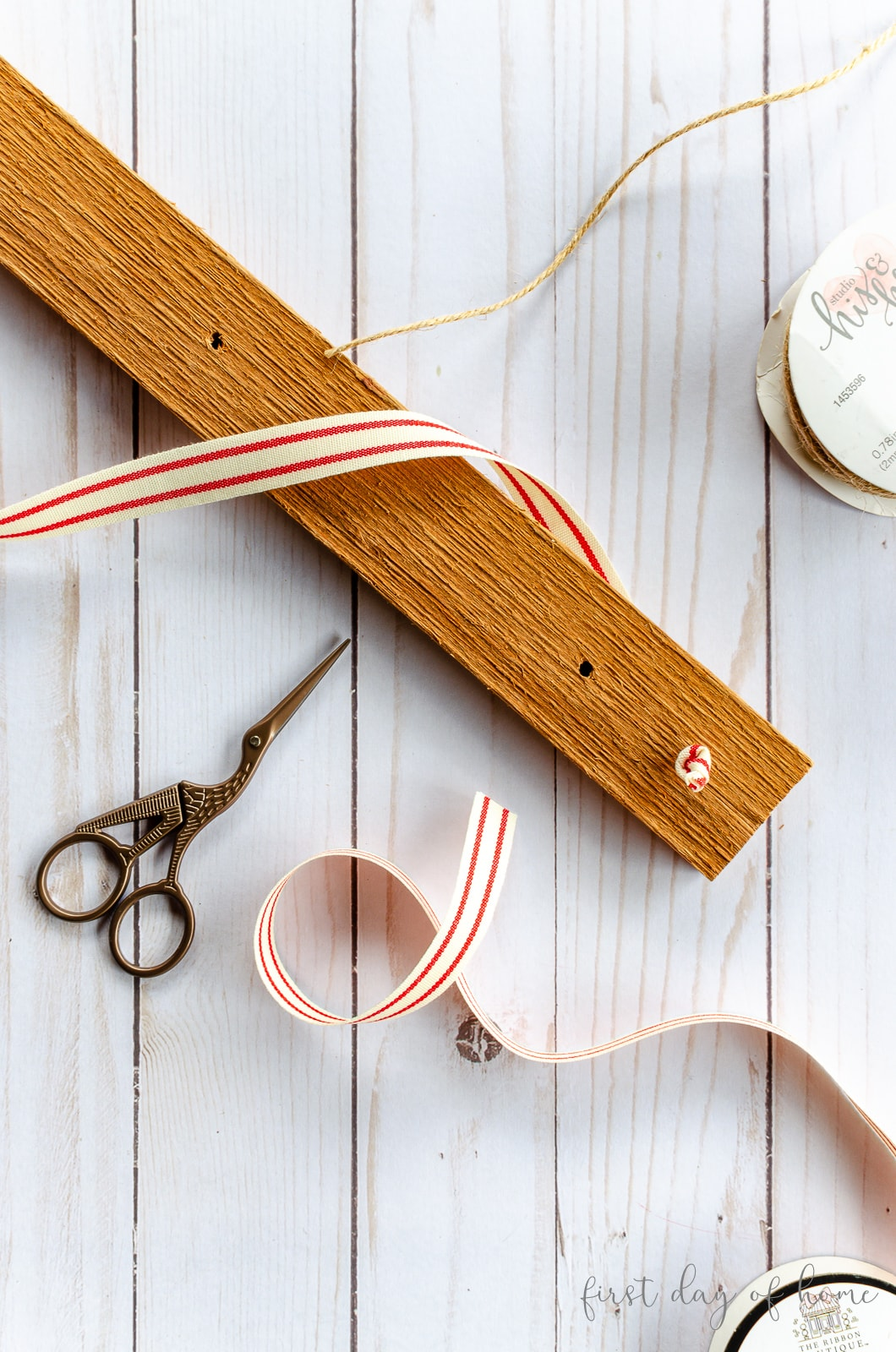 Attaching ribbon and jute cord to wood for DIY Christmas card holder