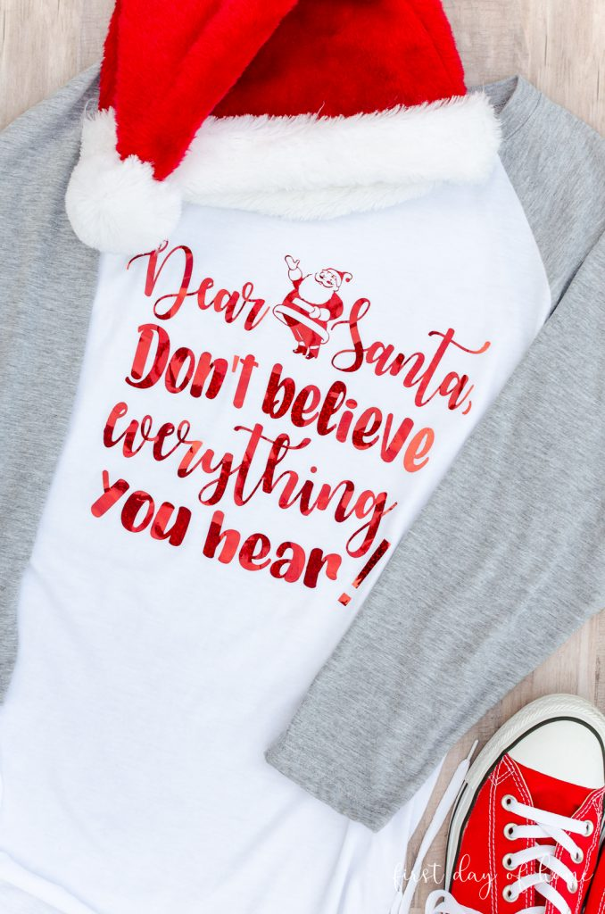 "Santa SVG file used on white and grey raglan t-shirt that reads ""Dear Santa, Don't believe everything you hear!"""