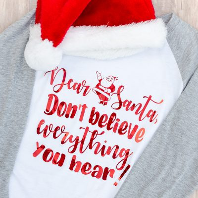 """Santa SVG t-shirt that reads """"Dear Santa, don't believe everything you hear!"""" with red letters and raglan tee with Santa hat"""