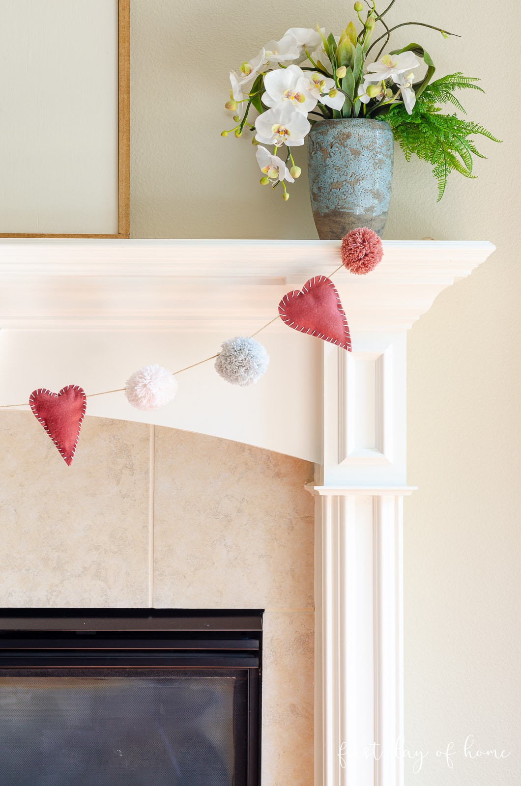 Valentine garland with hearts and pom poms