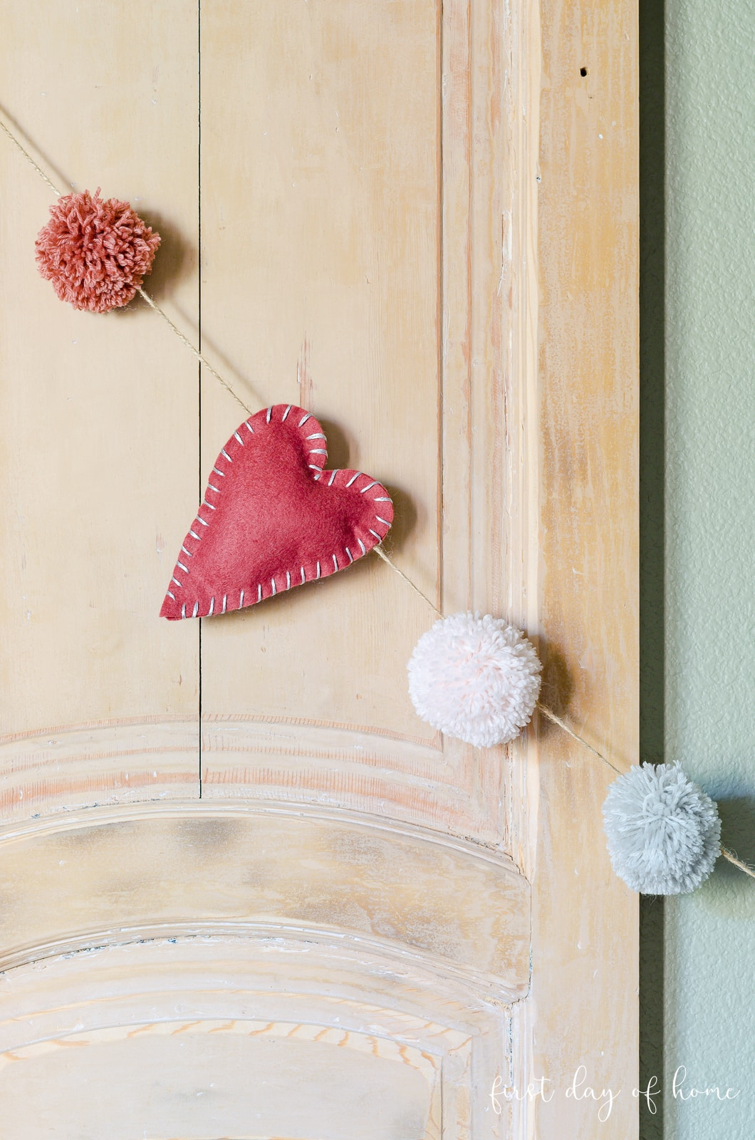 Valentines Day garland with pink ombre pom-poms and felt hearts