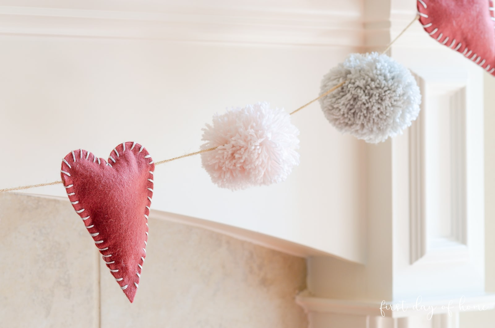 Valentines day garland with felt hearts and pom-poms