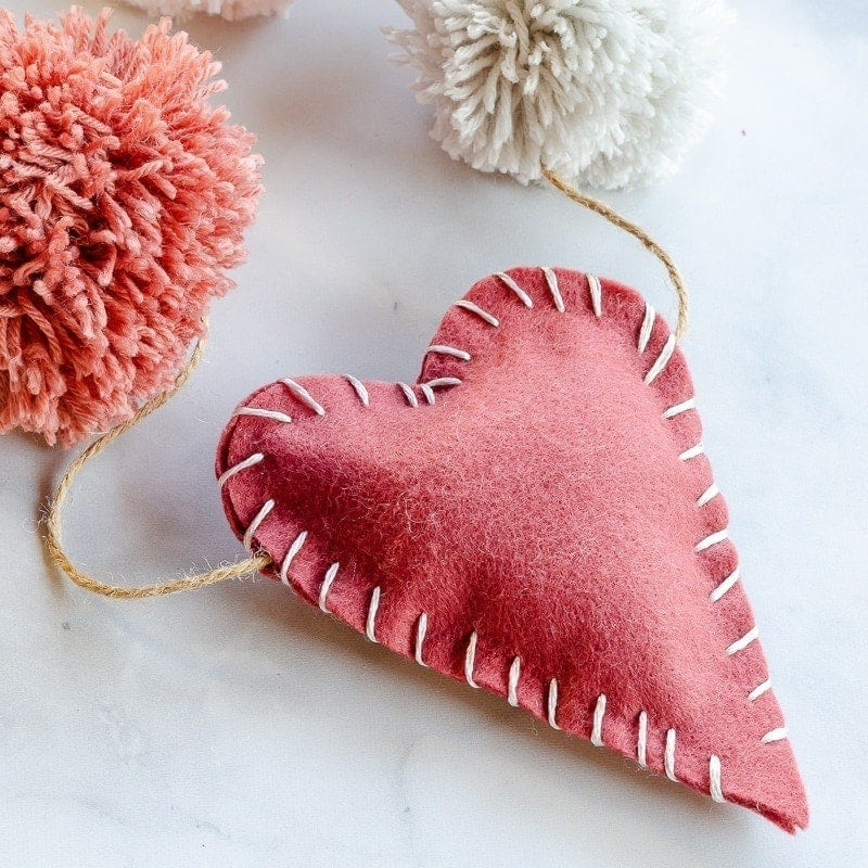 Valentine garland with felt hearts and pom poms
