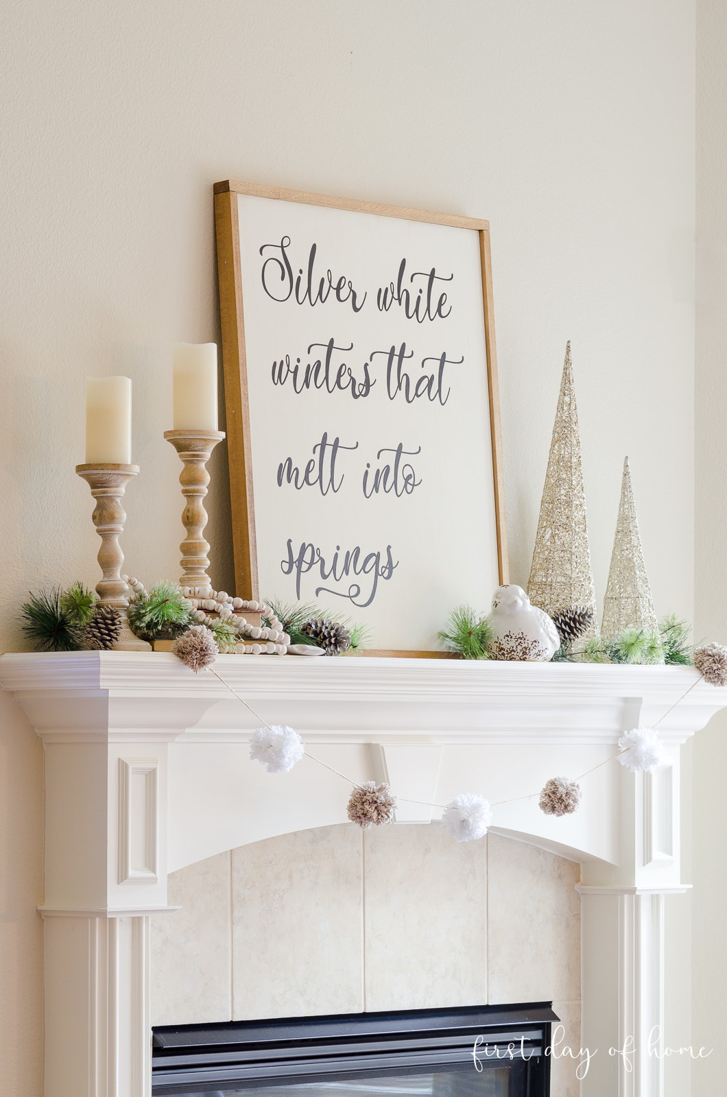 Winter mantel decor ideas with DIY farmhouse sign, pom pom garland and candles