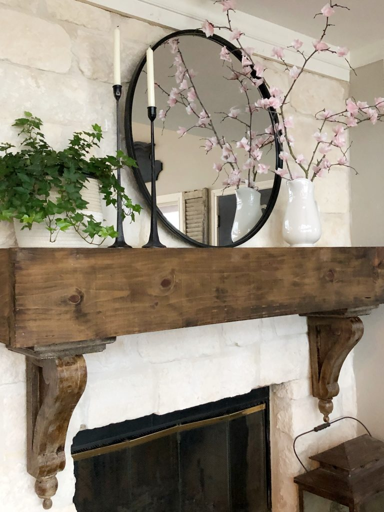 Faux cherry blossoms on spring fireplace mantel