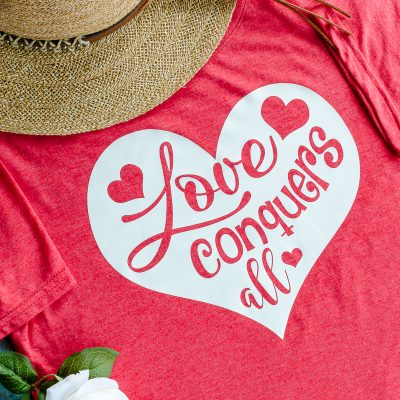 Love SVG file with phrase Love Conquers All