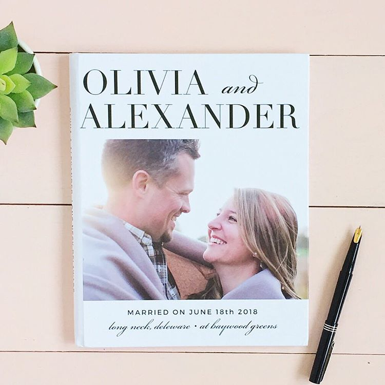Wedding guest book with photo of engaged couple