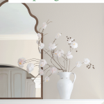 Spring mantel with cherry blossoms in pitcher and Moroccan mirror
