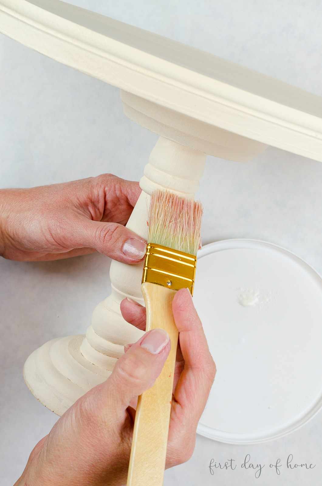 Applying clear wax to chalk paint on DIY cake stand