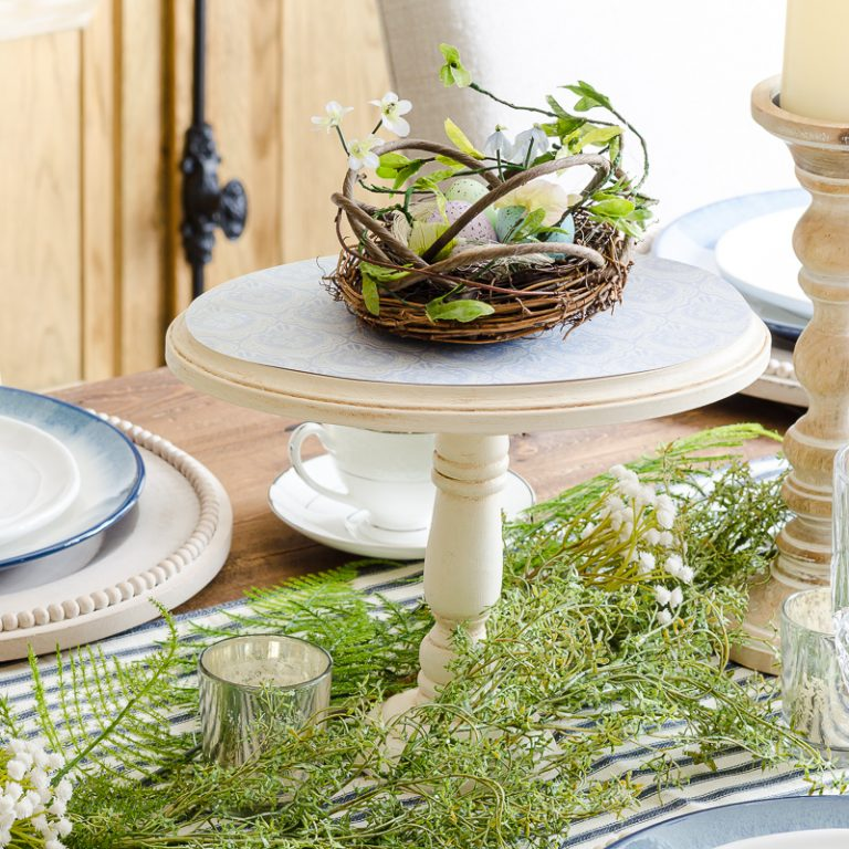 DIY cake stand holding bird's nest on spring table